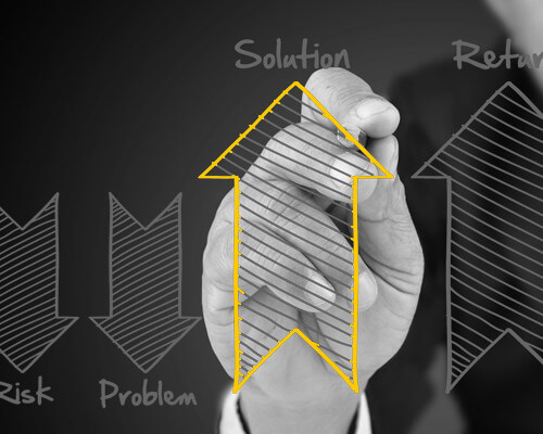 Image of man drawing up and down direction arrows related to business data. Solution Selling Training Research & Published Insights from LSA Global, Inc