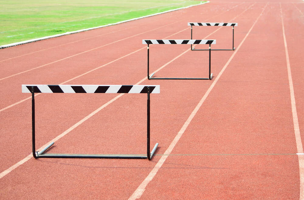 3 hurdles on the track to represent Sales Leadership Barriers to Success