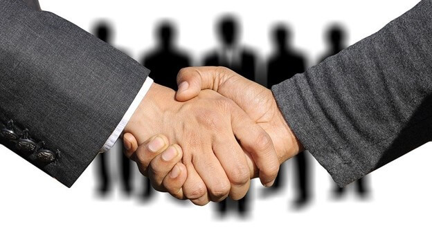 shaking hands to Build Better Sales Relationships